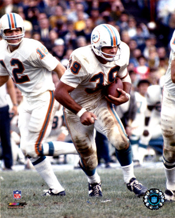 Bob Griese watches Larry Csonka Run